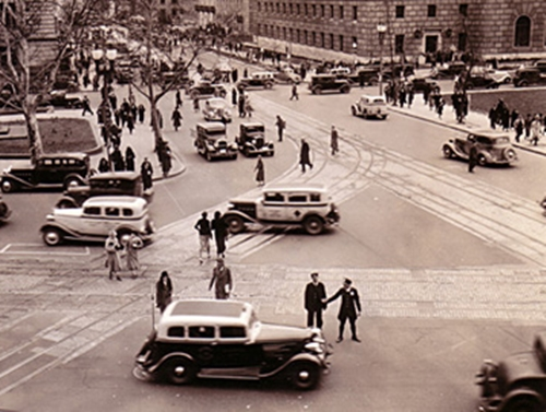 14th St and Penn Ave, NW - pedestrians, sutos, and streetcar tracks at busy intersection 1945