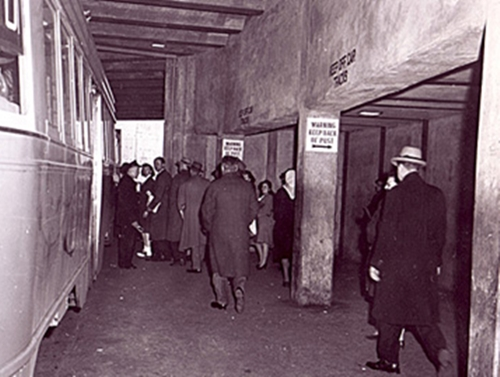 Passengers Loading - people walking past streetcar in underground station