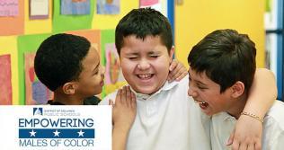 Photo of three school-aged boys smiling