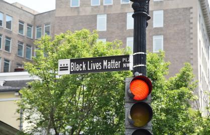 Black and white street sign for Black Lives Matter Plaza