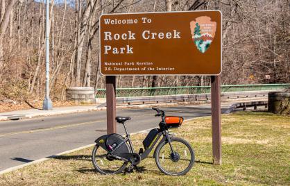 Capital Bikeshare bike by Rock Creek Park entrance sign