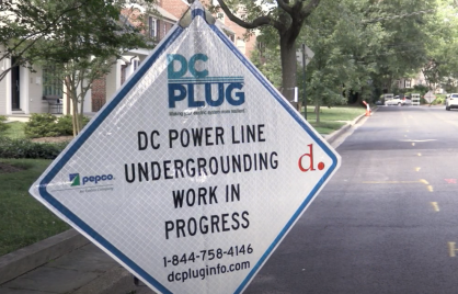 white sign with black letters announcing DC PLUG