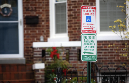 green and white residential parking sign