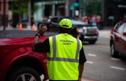 Pedestrian safety officer directing traffic in Washington DC