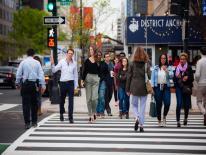 Pedestrians walking on crowded street in washington DC