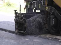 Close up of road paving machine