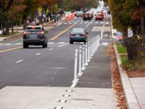 Street featuring bike lane vehicles and street trees