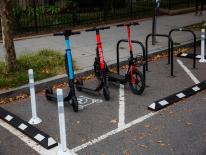 three deckles scooters in an on-street micro mobility corral