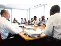 About DDOT - Who We Are - featuring a boardroom meeting