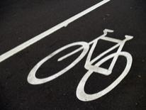 Bicycle Lanes - a bicycle symbol painted on asphalt to signify a bike lane