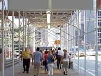 Pedestrian Safety and Work Zone Standards - Covered and Open Walkways - people walking under a covered construction walkway