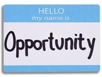 Business Opportunity and Workforce Development Center - white and blue name tag with the word Opportunity hand-printed on it
