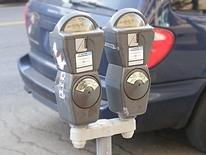 Parking Meters - gray double-headed standard parking meter