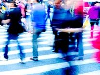 On Your Street - multi-colored pedestrians blurred while crossing intersection