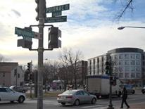 Pennsylvania Avenue SE Transportation Study - intersection scene with buildings, cars, and a traffic light pole