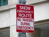 Snow Emergency Vehicle Towing Policy - red and white snow emergency sign on a street pole