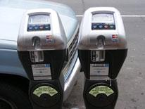 Solar-powered single space double-headed parking meters