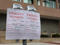 Take a Parking Meter Out of Service - temporary Emergency No-Parking signs hung on parking meters