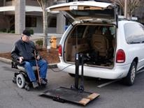 Transportation for the Elderly and Persons with Disabilities Program- man in wheelchair accessing the back of a white a van, outfitted for the disabled - Guide