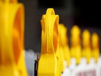 Image of yellow, light-topped road barriers, lined up