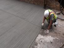 Worker repaving alley