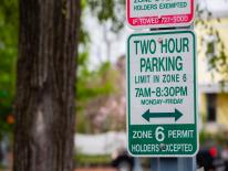 green and white parking sign