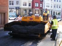 photo of a street paving machine