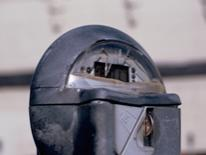 Report a Broken Parking Meter - grey parking meter with a broken dome