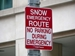 Snow Emergency Vehicle Towing Policy - 'no parking' red and white snow emergency route sign