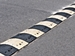 Traffic Calming - black-and-white-striped speed hump